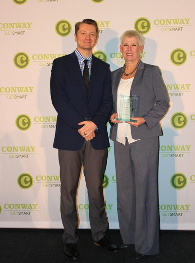 Stephana Loyd, vice president and chief nursing officer at Baptist Health Medical Center – Conway, was named the 2018 Administrator of the Year. Loyd is pictured with Paul Bradley of Edafio Technology Partners, the sponsor of the Administrator of the Year award.