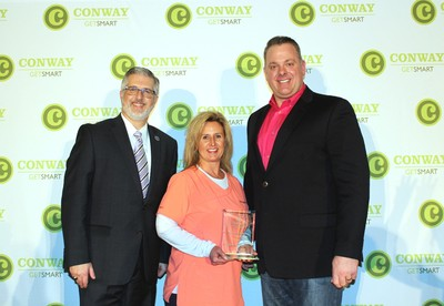 Kimberly-Clark Corporation received the 2018 Workplace Wellness Award at the University of Central Arkansas North Metro Healthcare Awards. Pictured with UCA president Dr. Houston Davis (left) are Shea Johnson and Chris Boudrie of Kimberly-Clark. Sam's Club was the sponsor of the Workplace Wellness Award.